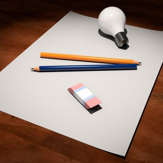 pencils, eraser and lightbulb on a blank piece of paper