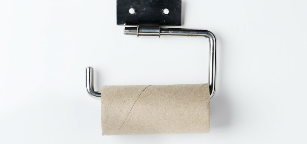 empty toilet roll on wall holder