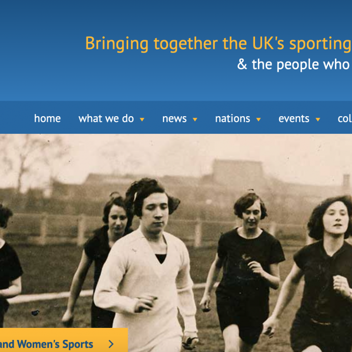 Screenshot of the Sporting Heritage website's homepage showing an antiquated image of women running.